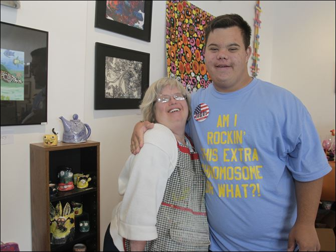 Linda Richards and Tyler Wiley show off  Linda Richards and Tyler Wiley show off some of their artwork at Shared Lives Studio, which will have a table selling  art at the upcoming Buddy Walk to benefit the Down Syndrome Association of Greater Toledo.