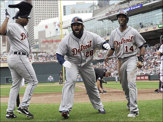 Tigers Twins Baseball 10-1 Detroit Tigers slugger Prince Fielder, center, celebrates with Delmon Young, left, and Austin Jackson after Fielder's two-run home run off Minnesota Twins pitcher Jared Burton in the eighth inning Sunday in Minneapolis. The Tigers won 2-1.