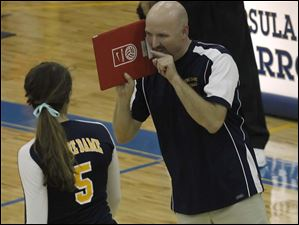 Notre Dame's Maddy Smith listens to head coach Jeff Pitzen.