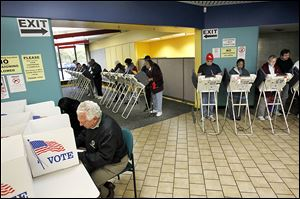 Lucas County residents take the opportunity to vote early at the Early Voting Center set up in Summit Center, former Riverside Hospital, on Summit Street in North Toledo.