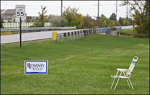 An empty chair sits next to a Romney/Ryan sign Tuesday at Roachton Road and Hull Prairie Road in Perrysburg. About a month remains until Election Day.