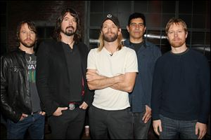 The Foo Fighers, from left, Chris Shiflett, Dave Grohl, Taylor Hawkins, Pat Smear, and Nate Mendel.