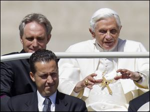 Pope Benedict XVI, flanked by his private secretary Georg Gaenswein, top left, and his butler Paolo Gabiele at St.Peter's square at the Vatican.