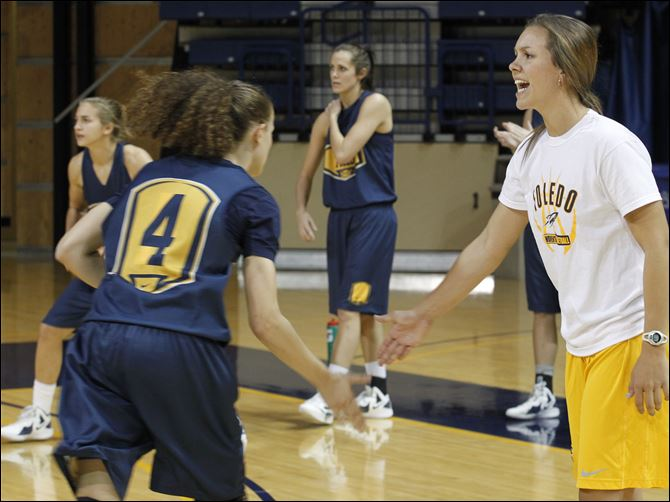 UT women's bball UT senior and team captain Naama Shafir, left, slaps hands with graduate assistant/manager Jessica Slagle during practice Tuesday at UT's Savage Arena.