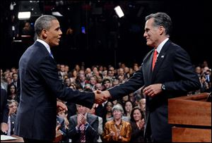 President Barack Obama shakes hands with Republican presidential nominee Mitt Romney after their first presidential debate tonight at the University of Denver.