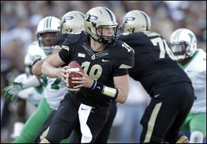 Purdue quarterback Caleb TerBush drops back to throw against Marshall earlier this season.
