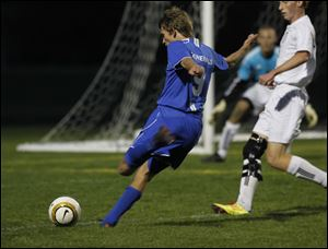 Anthony Wayne's Alex Hansen takes a shot on goal earlier this season.