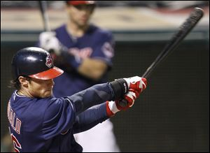 Cleveland Indians' Jason Donald hits an RBI single off Chicago White Sox's Nate Jones in the 12th inning.