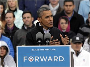 President Obama speaks at a campaign rally in Denver today.