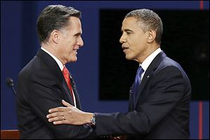 Republican presidential nominee Mitt Romney and President Obama shake hands after the first presidential debate at the University of Denver last week.