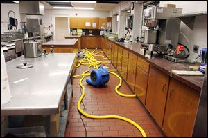 Cleaning equipment does its work in the kitchen area of the Islamic Center of Greater Toledo, which sustained damage in every room, said center President Mahjabeen Islam.