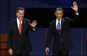 Republican presidential nominee Mitt Romney and President Barack Obama  wave to the audience during the first presidential debate at the University of Denver on Wednesday.