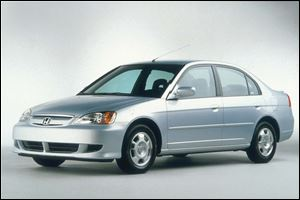 This 2003 Honda Civic Hybrid looks just like its gasoline-powered siblings, but its key attribute is a hybrid engine that runs on both gasoline and electricity.