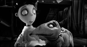Victor Frankenstein, voiced by Charlie Tahan, with Sparky, in a scene from