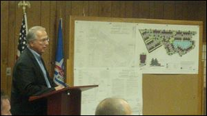 George Oravecz, consulting engineer for Redwood Development, discusses plans for the next phase of the Barrington Place subdivision Wednesday at the Perrysburg Township trustee meeting.