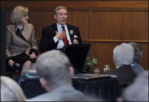 Guest speakers Barbara and John Cochran, a former ABC News reporter, answer questions about journalism and politics from the audience Wednesday at the Toledo Club.
