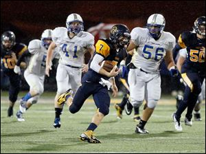Whitmer quarterback Nick Holley (7) breaks free for a long run during the second quarter.