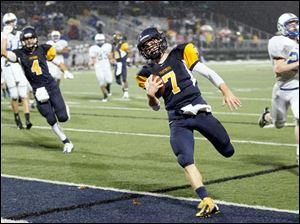 Whitmer's Nick Holley (7) scores a touchdown.