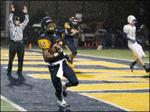 Whitmer's Tre Sterritt (12) scores a touchdown during the second quarter against Findlay.