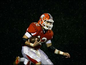 Southview's Damian Griesinger runs through the rain as he keeps an eye on the Bowling Green players.