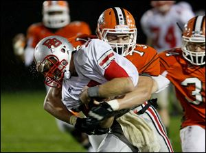 Andrew Dennis of the Bowling Green Bobcats is taken down by Ryan Stout of the Southview Cougars.