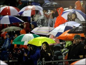 Southview fans endure the rain during their game against Bowling Green at Northview High School.
