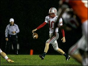 Andy Fisher, of the Bowling Green Bobcats, punts the ball toward the receiving Southview Cougars.