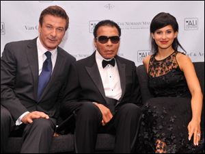 Actor Alec Baldwin, former boxing champion Muhammad Ali and Hilaria Thomas Baldwin at Thursday's benefit.