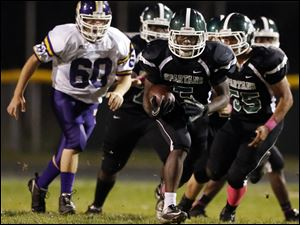 Start running back Deshawn Woodward runs had 288 yards on 26 rushes for the victorious Spartans.