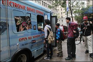 Cellphones are banned in all New York City public schools, but the rule is widely ignored except in schools with metal detectors. Outside those schools, entrepreneurs park trucks where students drop off devices before class and get them back at the end of the day.