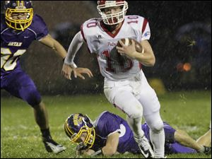 Bryan defenders put pressure on Patrick Henry quarterback Gabe Jones during their Northwest Ohio Athletic League matchup on Friday night.