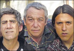 Mike Watt, center, with Tom Watson, left and Raul Morales of the band Missingmen.