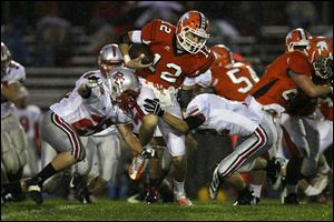 Southview's Damian Griesinger runs the ball against Bowling Green on Friday night in Sylvania.