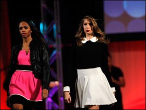 Ashley Kynard and Ashley Taylor make their way down the runway during the Epic Rocks Fashion Show.
