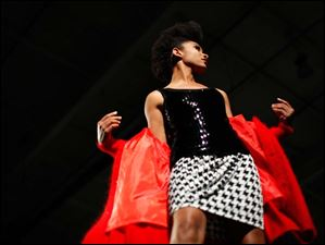 Zahra Collins strikes a pose as she models clothing at EPIC Rocks Fashion Show at Grande Air Hangar in the Toledo Express Airport