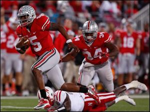 A Nebraska defender fails to catch Ohio State's Braxton Miller (5) as he scores a touchdown.