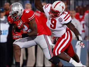 Ohio State running back Rod Smith (2) eludes Nebraska defender Jason Ankrah (9) to score a touchdown in the fourth quarter.