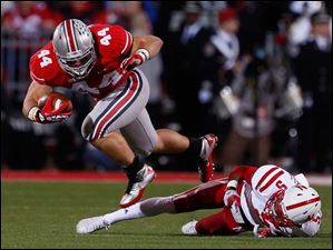 Ohio State's Zach Boren (44) runs the ball against  Nebraska's Josh Mitchell (5).