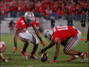 Ohio State defender Ryan Shazier (10) chases Nebraska QB Taylor Martinez's fumble during the second quarter.