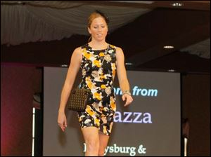 Ali McMaster, struts the catwalk wearing a dress and accessories from Ragazza.