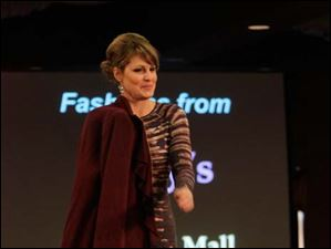 Lisa Rosanski modeling clothes from Macy's at the Auxiliary to the Ability Center's the Magic of Fashion style show.