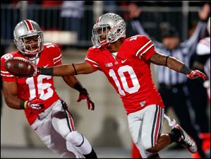 Ohio State's Corey Brown (10) celebrates his touchdown.