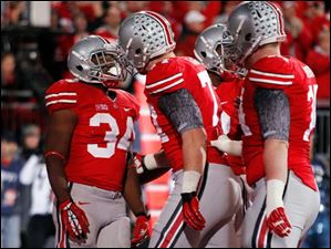 Ohio State's Carlos Hyde (34) celebrates scoring a touchdown against  Nebraska during the second quarter.