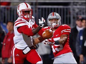 Nebraska's Stanley Jean-Baptiste (16) breaks up a pass intended for Ohio State receiver Devin Smith (15) during the third quarter.