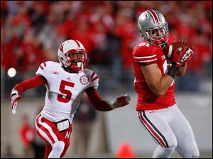 Ohio State wide receiver Nick Vannett (81) makes a catch against  Nebraska's Josh Mitchell (5) during the second quarter.