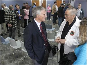 U.S. Rep. Bob Latta, left, speaks with North Baltimore resident Keith Harris.