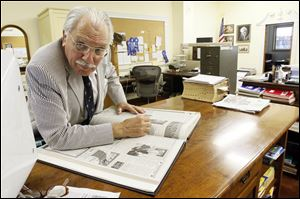 Ross Taylor, the Publisher/Editor of the Archbold Buckeye works in the newsroom of the newspaper.