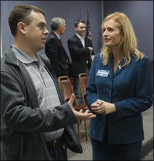 Libertarian state House of Representatives candidate Nathan Eberly converses with Democratic U.S. Congressional District 5 candidate Angela Zimmann.