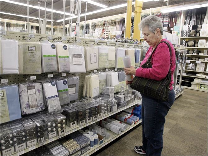 BIZ andersons04p June Rollins June Rollins of Temperance shops at the Andersons in Toledo. The Maumee-based retailer added about 10,000 more items within retail soft lines categories such as linens, towels, cookware, and room accessories, giving consumers more for their homes.
