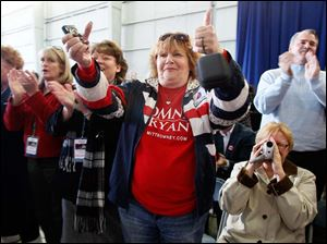 Supporters including Kathye Zaper of Maumee, center, cheer Mitt Romney's running mate.